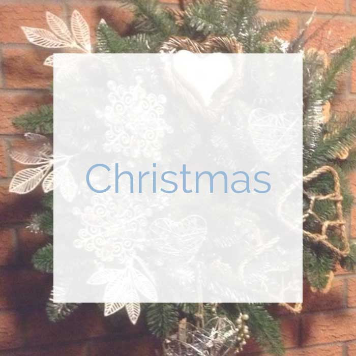 Festive Christmas flower arrangements and wreaths